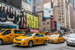 Pedestrians and Vehicles move along Broadway in Times Square in New York City Royalty Free Stock Image