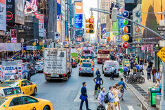 Pedestrians and Vehicles move along Broadway in Times Square in New York City Stock Photography