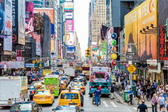 Pedestrians and Vehicles move along Broadway in Times Square in New York City Royalty Free Stock Photo