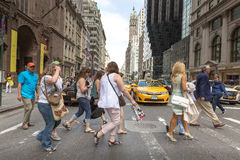 Pedestrians and Vehicles move along 5th Avenue in New York City Royalty Free Stock Photos