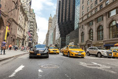 Pedestrians and Vehicles move along 5th Avenue in New York City Royalty Free Stock Image