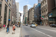 Pedestrians and Vehicles move along 5th Avenue in New York City Stock Photos