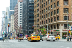 Pedestrians and Vehicles move along 5th Avenue in New York City Royalty Free Stock Images