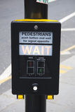 Pedestrians wait. Close-up of a British pedestrain crossing signal button Royalty Free Stock Photos