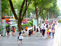 Pedestrians walk along Orchard Road Royalty Free Stock Image