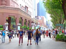 Pedestrians walk along Orchard Road Stock Image