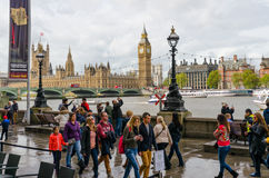 Pedestrians walk along the river Thames Royalty Free Stock Photography