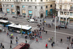 Pedestrians walk and cars go at Gran Via street Stock Images