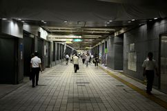 Pedestrians walk through underground tunnel at Shinjuku station Tokyo Japan Royalty Free Stock Photography