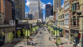 Pedestrians walking along Stephen Avenue stock video footage