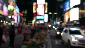 Pedestrians walking in city night with lights stock footage