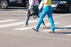 Pedestrians walking on a crosswalk Stock Image