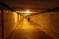 Free Pedestrians Walking In The Underpass Stock Photography - 181697292