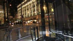 Pedestrians walking night street. Beautiful illuminated Vancouver street pan 20 Sept 2016 stock video footage