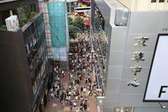 Pedestrians walking on a street in Causeway Bay, Royalty Free Stock Photo
