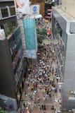 Pedestrians walking on a street in Causeway Bay, Stock Photo