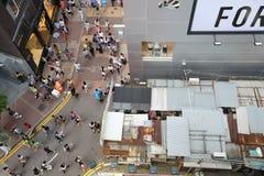 Pedestrians walking on a street in Causeway Bay, Stock Image