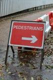 Pedestrians this way sign. Stock Photos