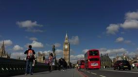 Pedestrians on Westminster Bridge with Big Ben London. LONDON, UK - APRIL 27, 2015: Pedestrians travel along Westminster Bridge against a bright morning view of stock video