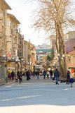 Pedestrians on the winter street in Burgas, Bulgaria royalty free stock images