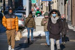 Free Pedestrians With Face Masks For Protection From COVID-19 Walking Down The Street Stock Photo - 211412320