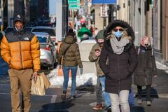 Free Pedestrians With Face Masks For Protection From COVID-19 Walking Down The Street Stock Images - 211412324