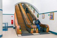 Pedestrians at wooden escalator in hiking tunnel river Schelde, Antwerp Royalty Free Stock Photos