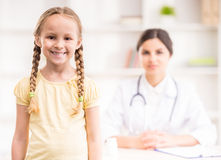 Pediartician. Little cute smiling girl standing at doctor's office Royalty Free Stock Photo
