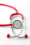 Pediatric #3. Red stethoscope with green pacifier isolated Stock Photos