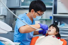 Pediatric dentistry, prevention dentistry, oral hygiene concept. Mechanical way of professional teeth cleaning, painless procedure, dentist at work stock image