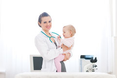 Pediatric doctor and baby on survey Stock Photos