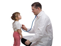 Pediatric doctor checking heartbeat with stethoscope Royalty Free Stock Photography