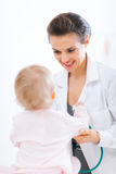 Pediatric doctor examine baby Royalty Free Stock Images