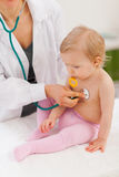 Pediatric doctor examine baby Stock Image