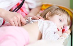 Pediatric doctor examining little baby girl Royalty Free Stock Photo