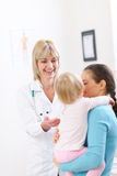 Pediatric doctor talking with mother and baby Royalty Free Stock Photo