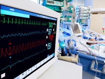 Pediatric ICU with ECG monitor. On foreground stock photos