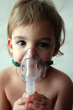 Pediatric Nebulizer Treatment 2. A little girl looks sad as she takes her nebulizer breathing treatment Stock Photo