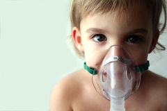 Pediatric Nebulizer Treatment 3. A little girl looks sad as she takes her nebulizer breathing treatment. There is room to the left of the subject for text Royalty Free Stock Photography