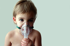 Pediatric Nebulizer Treatment 6. A little girl looks sad as she takes a nebulizer breathing treatment. There is room to the right of the subject for text Royalty Free Stock Image