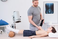 Pediatric physiotherapist treating little patient Royalty Free Stock Photography