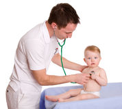 Pediatrician. A pediatrician and a child on white background Stock Photo