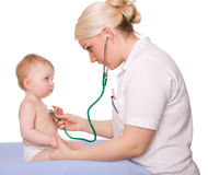 Pediatrician. A pediatrician and a child on white background Royalty Free Stock Photography