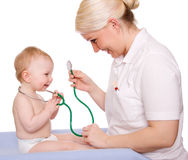 Pediatrician. A pediatrician and a child on white background stock images
