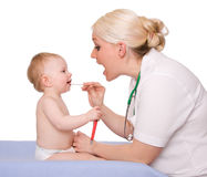 Pediatrician. A pediatrician and a child on white background stock image