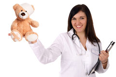 Pediatrician. Young doctor with sick teddy Royalty Free Stock Photos