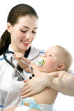 Pediatrician. A doctor holding a baby on the hands royalty free stock photos