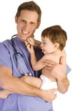 Pediatrician. Male pediatrician holding a baby boy on white Stock Images