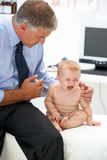 Pediatrician with baby Stock Images