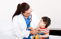 Pediatrician and Baby. Young female pediatrician doctor examining a baby boy patient Royalty Free Stock Photography